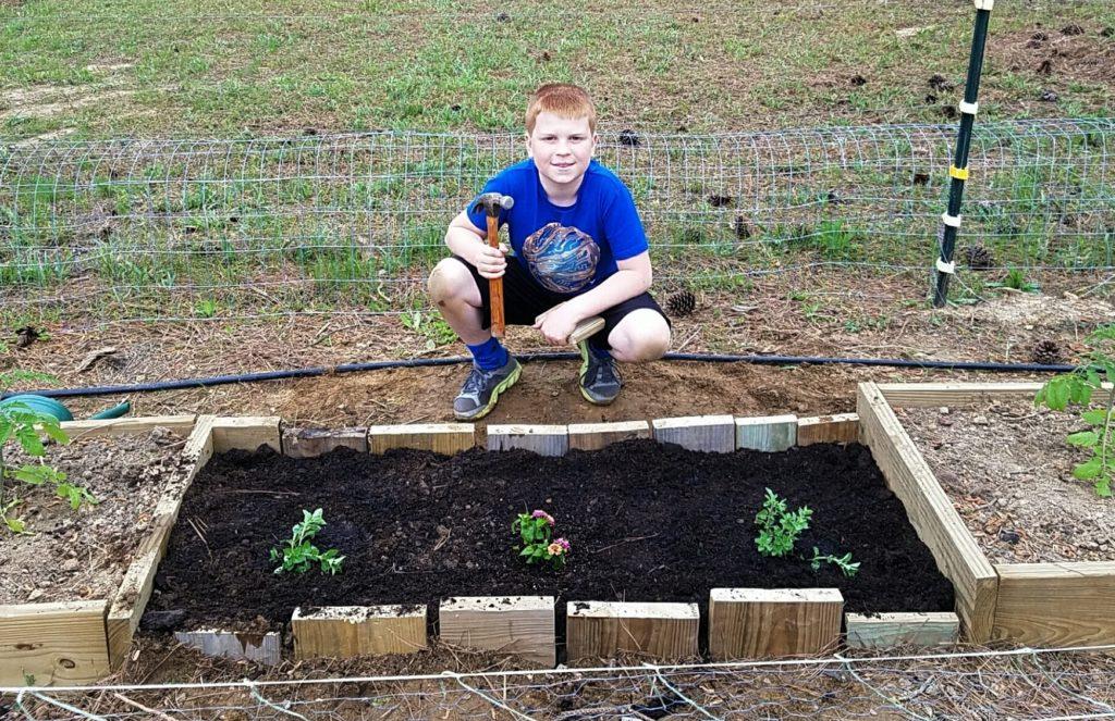 Kids building flower bed
