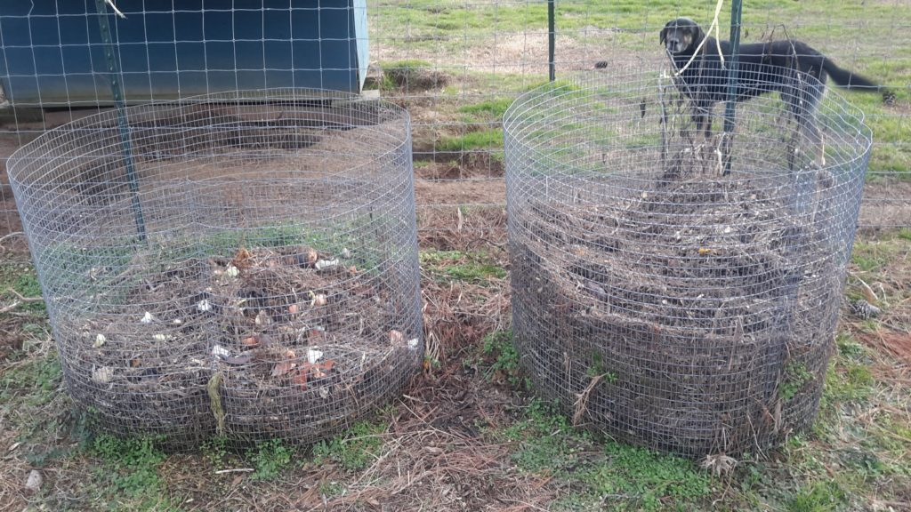 Compost piles in different decomposing stages