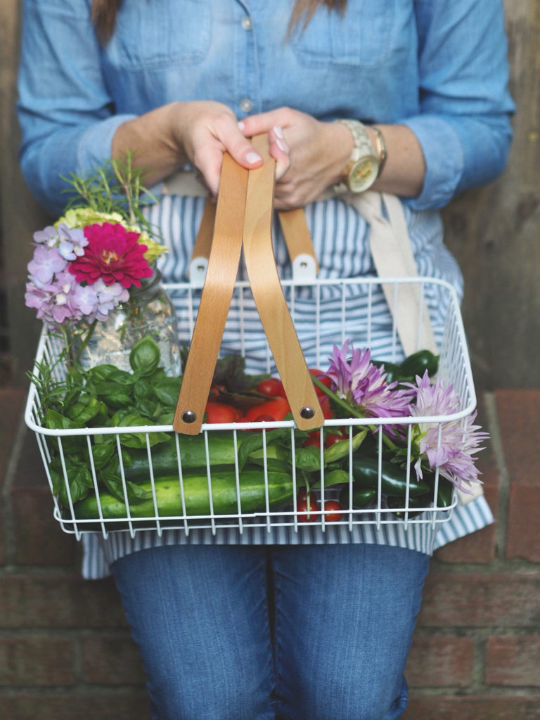 Basket with flowers and vegetables