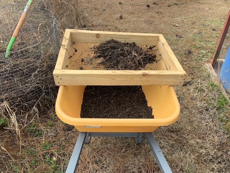 Using a compost sifter in the garden
