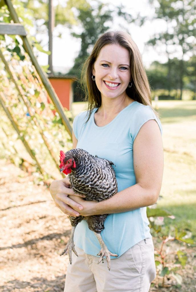 gardener with chicken in garden
